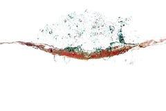Spruzzata di acqua dei colori rossi psichedelici Fotografie Stock Libere da Diritti