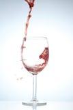 Spruzzata di vino rosso Fotografie Stock Libere da Diritti