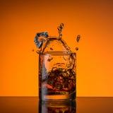 Spruzzata e ghiaccio del whiskey Immagine Stock
