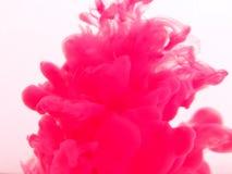 Spruzzata rosa di inchiostro Fotografia Stock