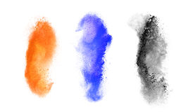 Spruzzata variopinta della polvere su fondo nero Fotografia Stock