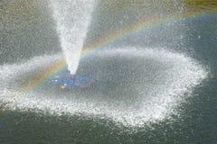 Spruzzatore dell'acqua con il Rainbow Immagini Stock Libere da Diritti
