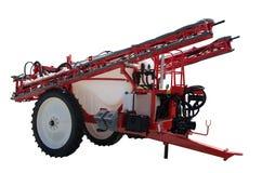 Spruzzatori trascinati trattore dall'attrezzatura di terre coltivabili Su una priorità bassa bianca Isolato Fotografie Stock
