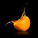 Spruzzatura del succo d'arancia Fotografia Stock