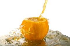 Spruzzatura del succo d'arancia Immagine Stock