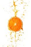 Spruzzatura del succo d'arancia Immagini Stock Libere da Diritti