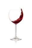 Spruzzatura del vino rosso in un vetro Fotografie Stock Libere da Diritti