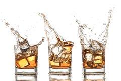 Spruzzatura del whiskey Fotografie Stock Libere da Diritti