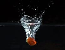 Spruzzatura della fragola Fotografie Stock