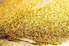 Spruzzi il fondo astratto strutturato della polvere di oro di scintillio Immagini Stock Libere da Diritti