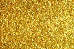 Spruzzi il fondo astratto strutturato oro di scintillio Fotografia Stock Libera da Diritti