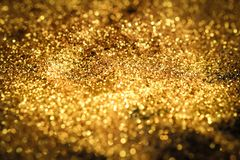 Spruzzi la polvere di oro di scintillio Fotografia Stock Libera da Diritti