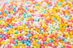 Spruzzi lo zucchero per il dolce che cucina il fuoco selettivo del fondo Immagini Stock