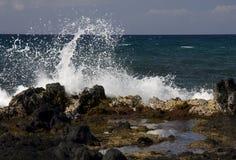 Spruzzo sulle rocce della lava Fotografia Stock Libera da Diritti