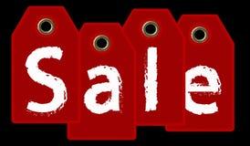 Sprzedaż oznacza A prezenta czerwone etykietki z ` sprzedaży ` tekstem - 3d odpłacają się na czerni zdjęcie stock