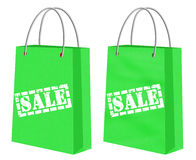Sprzedaż podpisuje na zielonym Kraft robi zakupy papierowe torby Zdjęcia Royalty Free
