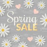 Sprzedaż znak z mieszkaniem kwitnie nad drewnianym stołem Wiosny pojęcie również zwrócić corel ilustracji wektora Obrazy Stock