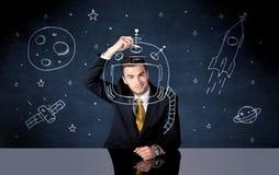 Sprzedaży osoby rysunkowy hełm i astronautyczna rakieta Fotografia Royalty Free