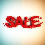 Sprzedaży słowo od czerwonych piłek ilustracja wektor