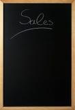 Sprzedaże na blackboard Zdjęcia Stock