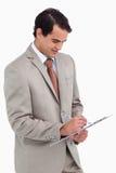 Sprzedawca bierze notatki Obrazy Royalty Free