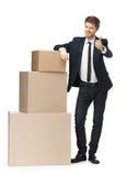Sprzedawca poleca towary konsumpcyjne Zdjęcie Stock