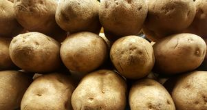 Spuds. A shot of potatoes on display Stock Photography