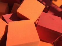 Spugne rosse ed arancio del cubo fotografia stock libera da diritti