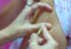 Spuit en naald en verpleegster Royalty-vrije Stock Afbeelding
