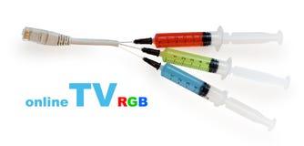Spuiten met gekleurde vloeistof Stock Foto's