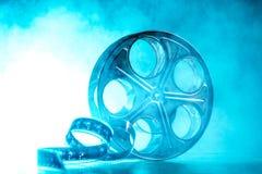Spule des Filmes mit Rauche und Hintergrundbeleuchtung Lizenzfreie Stockfotos
