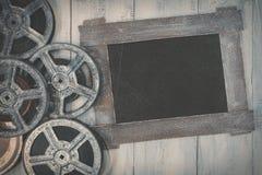 Spulen des Filmes und des schwarzen Brettes Stockfotos