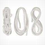 Spulen des Seils auf Weiß Stockbild