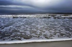 Spuma e spiaggia Fotografia Stock Libera da Diritti