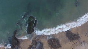 Spuma sulla costa di Gower archivi video