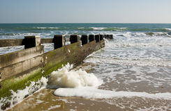 Spume on groyne, Dorset Stock Image