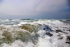 The Spume of the sea wave on song. Royalty Free Stock Photography