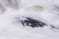 Spuming waves on the river. Angry cold river caught in the spring time Royalty Free Stock Image