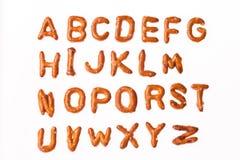 Spuntini della fonte della lettera del carattere della ciambellina salata di alfabeto Fotografia Stock