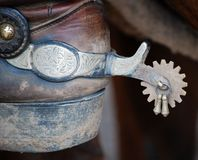 A spur on a working cowboys boot Stock Photo