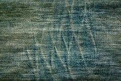 Spuren auf einem Paar Jeanshintergrundbeschaffenheit stockfotografie