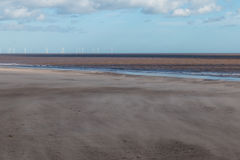 Spurn Head Point Wind Farm. Out at sea. Sand blowing across the beach Royalty Free Stock Photos