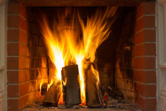 Spurts of flame. Fire blaze. Fire in fireplace. Fire background. Blazing Bonfire. Firewood burns in a fireplace. Fire blaze Royalty Free Stock Photography