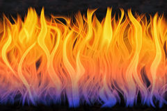 Fire flames. An illustration of forks of flame burning in darkness. The night scene of burning inferno is filled with spurts of fire and flying sparks. The heat Stock Photography