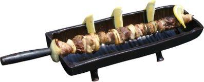 Sputo della griglia del BBQ con il pasto e le verdure Immagine Stock