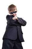 Spy. Close-up of boy in business suit. Shot in studio. Isolated with clipping path Stock Photography