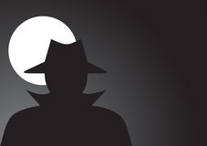 Spy. Unknown man in hat on the dark Royalty Free Stock Photo