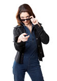Spy. Woman with sun glasses isolated on the white background Royalty Free Stock Photo