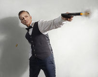 Spy agent  with a gun Stock Photography