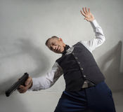 Spy agent with a gun Royalty Free Stock Photography